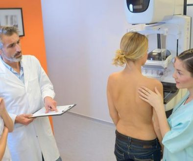 doctors talk as patient takes breast cancer screening